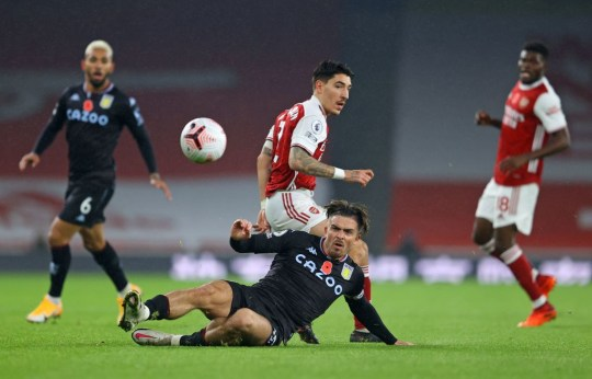 Aston Villa's English midfielder Jack Grealish (C) slides for the ball in front of Arsenal's Spanish defender Hector Bellerin (back) during the English Premier League football match between Arsenal and Aston Villa at the Emirates Stadium in London on November 8, 2020.