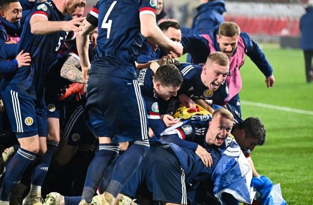 Scotland players celebrate their win over Serbia to reach Euro 2020