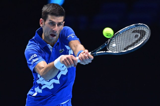 Serbia's Novak Djokovic returns to Germany's Alexander Zverev during their men's singles round-robin match on day six of the ATP World Tour Finals tennis tournament at the O2 Arena in London on November 20, 2020.