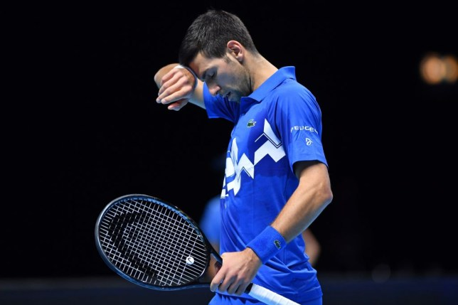 Serbia's Novak Djokovic gestures as he plays against Austria's Dominic Thiem in their men's singles semi-final match on day seven of the ATP World Tour Finals tennis tournament at the O2 Arena in London on November 21, 2020.
