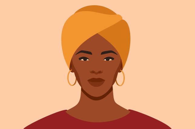 Black woman wearing a yellow hair wrap and hoop earrings