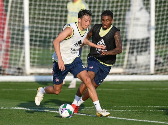 Mesut Ozil runs with the ball at Arsenal's training ground