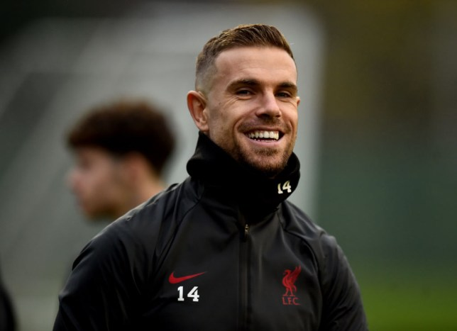 Jordan Henderson looks on in Liverpool training