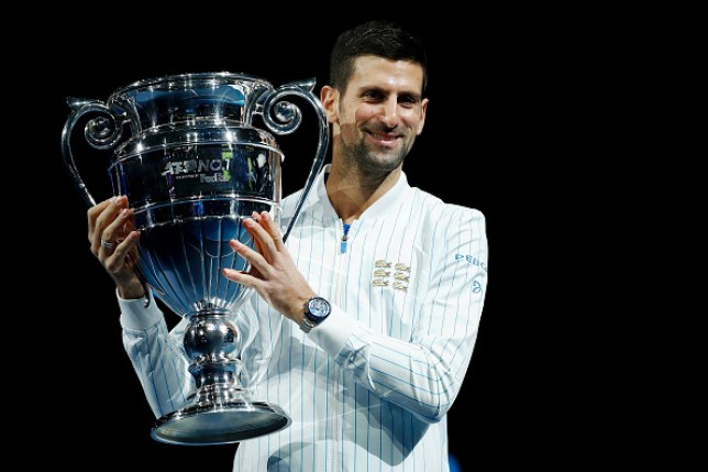 Novak Djokovic of Serbia poses with his trophy after being announced as ATP Tour end of year world number one during Day one of the Nitto ATP World Tour Finals at The O2 Arena on November 15, 2020 in London, England.