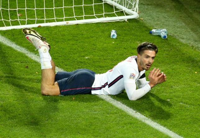 Jack Grealish lies on the floor during England's Nations League defeat to Belgium