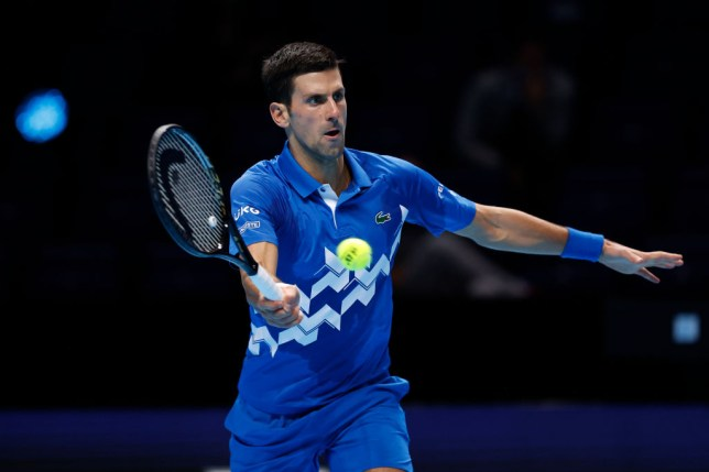 Novak Djokovic of Serbia  makes a return during his singles match against Daniil Medvedev of Russia during Day 4 of the Nitto ATP World Tour Finals at The O2 Arena on November 18, 2020 in London, England.