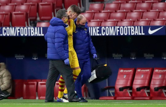 Gerard Pique had his head in his hands as he hobbled off the pitch in Barcelona's defeat to Atletico Madrid