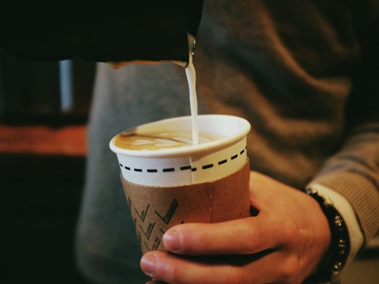 Cropped Image Of Man Pouring Coffee In Disposable Cup