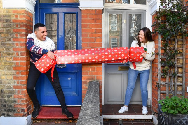 people pulling a 2 metre christmas cracker