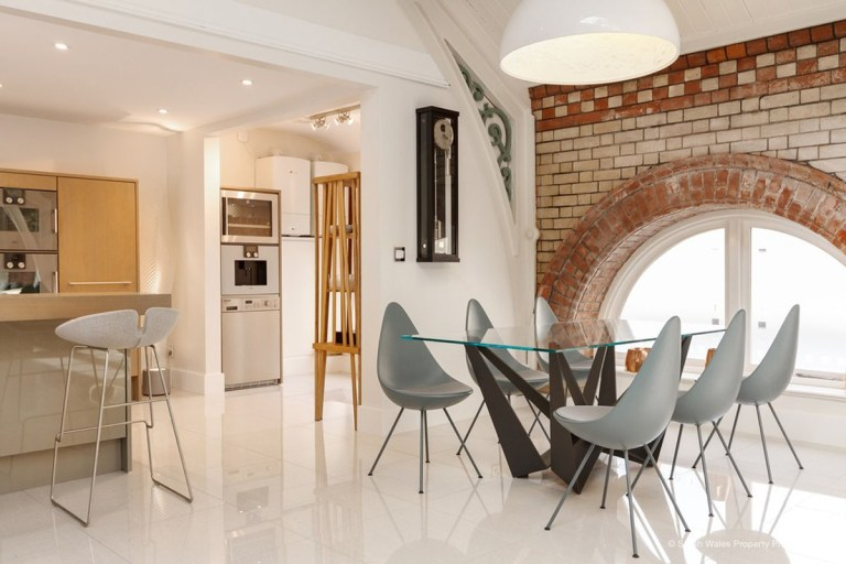 victorian municipal baths apartment on sale - dining area