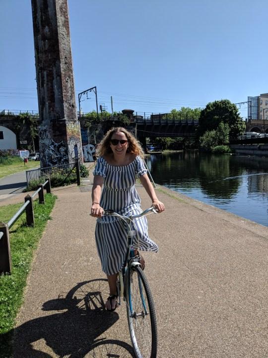 Laura Rowe bike riding along a canal