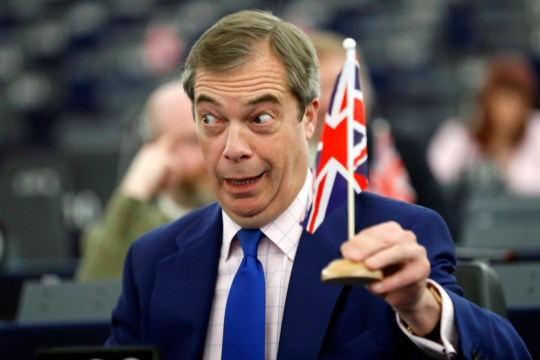 Former U.K. Independence Party (UKIP) leader and member of the European Parliament Nigel Farage holds a U.K. flag during a plenary session at the European Parliament in Strasbourg, eastern France.