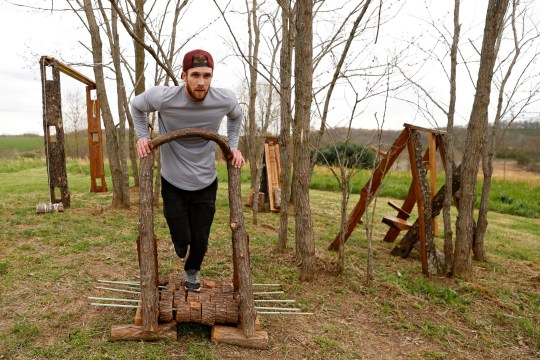 Zachary Skidmore runs on a treadmill on his hand-made outdoor gym equipment