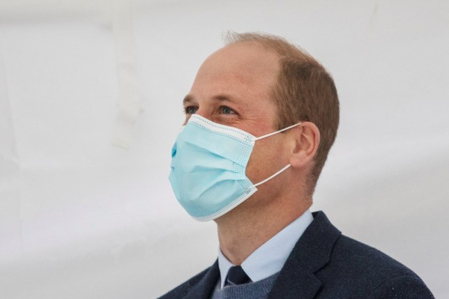 Prince William wearing a face mask.