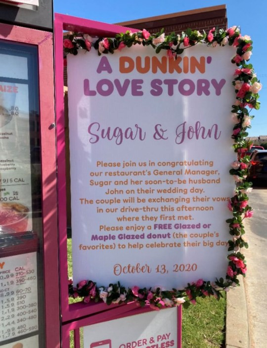 Sign congratulating couple and saying customers could have free dougnuts