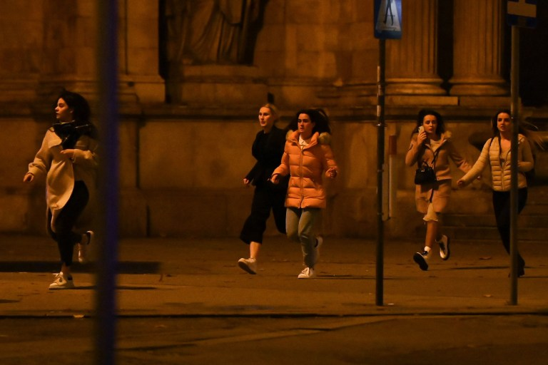 Women run away from the first district near the state opera, central Vienna on November 2, 2020, following a shooting near a synagogue. - Austrian Interior Minster Nehammer said late on November 2 that a shooting in central Vienna near a major synagogue appeared to be a terrorist attack and was ongoing. (Photo by Joe Klamar / AFP) (Photo by JOE KLAMAR/AFP via Getty Images)