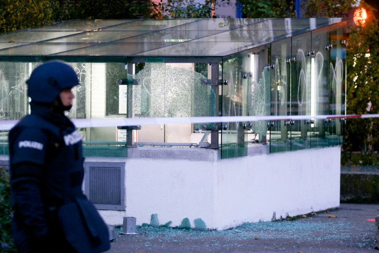 A police officer patrols in front of an entrance of a car parking with broken glasses after a shooting, in Vienna, Austria, Tuesday, Nov. 3, 2020. Police in the Austrian capital said several shots were fired shortly after 8 p.m. local time on Monday, Nov. 2, in a lively street in the city center of Vienna. Austria's top security official said authorities believe there were several gunmen involved and that a police operation was still ongoing. (Photo/Ronald Zak)