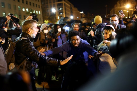Men gesture as protesters gather at Black Lives Matter Plaza near the White House in Washington, U.S., November 4, 2020. REUTERS/Hannah McKay