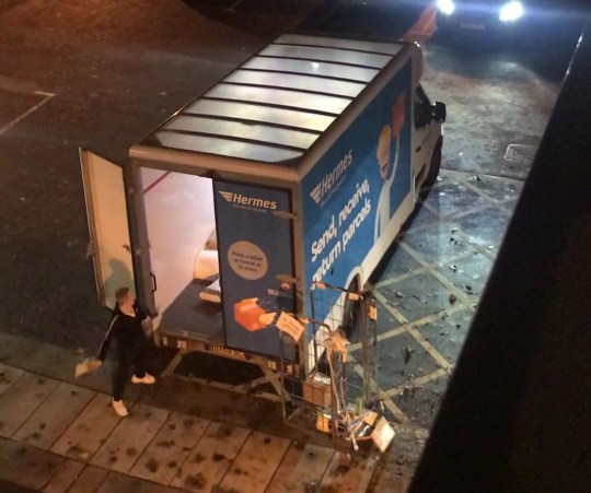 PIC FROM Kennedy News and Media (PICTURED: A HERMES DRIVER THROWING A PARCEL INTO HIS VAN) A disgusted dad claims Hermes could ruin Christmas for many after filming an 'angry' delivery driver launching packages into a van 'as hard as he could'. Shocking footage shows the courier appearing to take great pleasure in throwing parcels so violently they can be heard smashing into the sides of the delivery giant's vehicle. Wayne Millin watched on in horror as he recorded the man's antics from his girlfriend's flat above the Co-op in Barnwood, Gloucester, where Hermes collect parcels for their UK-wide service. DISCLAIMER: While Kennedy News and Media uses its best endeavours to establish the copyright and authenticity of all pictures supplied, it accepts no liability for any damage, loss or legal action caused by the use of images supplied and the publication of images is solely at your discretion. SEE KENNEDY NEWS COPY - 0161 697 4266