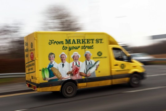 A Wm Morrison Supermarkets Plc branded customer delivery vehicle leaves the Ocado Group Plc distribution centre in Dordon, U.K., on Friday, Dec. 16, 2016. Ocado provides home delivery of a wide range of products including food and drink, toiletries and baby, household, pet care, and holiday products. Photographer: Chris Ratcliffe/Bloomberg via Getty Images