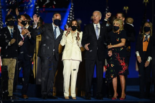 US President-elect Joe Biden (C-R) and Vice President-elect Kamala Harris (C-L) react as confetti falls, with Jill Biden (R) and Douglas Emhoff, after delivering remarks in Wilmington, Delaware, on November 7, 2020, after being declared the winners of the presidential election. (Photo by Jim WATSON / AFP) (Photo by JIM WATSON/AFP via Getty Images)