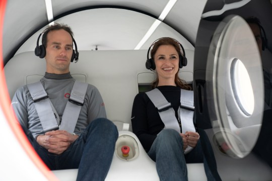 Virgin Hyperloop executives Josh Giegel, its Chief Technology Officer, and Sara Luchian, Director of Passenger Experience are seen inside a Virgin Hyperloop pod during testing at their DevLoop test site in Las Vegas, Nevada. (Reuters)