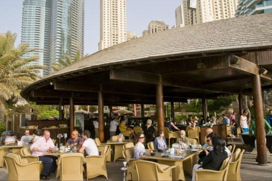 Mandatory Credit: Photo by David Pearson/REX/Shutterstock (918897i) People at the Hilton cafe restaurant bar in Dubai, United Arab Emirates. Dubai, United Arab Emirates - May 2009