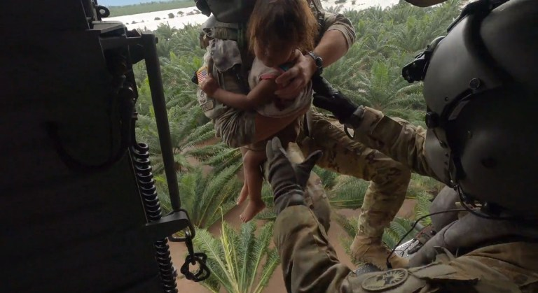 A U.S. Army HH-60 Black Hawk helicopter crew assigned to the 1-228th Aviation Regiment, Joint Task Force-Bravo rescues a Honduran child from Hurricane Eta?s high floodwaters at San Pedro Sula, Honduras, Nov. 6, 2020.