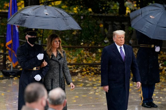 President Donald Trump and first lady Melania Trump observe Veterans Day at Arlington National Cemetery in Arlington, Va., Wednesday, Nov. 11, 2020. (AP Photo/Patrick Semansky)