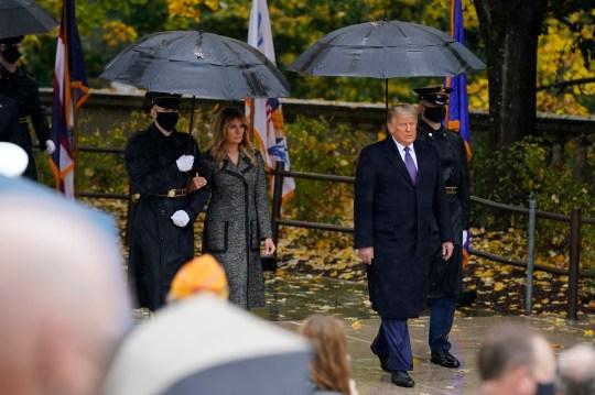 Melania Trump with serviceman next to Donald at Arlington Cemetery
