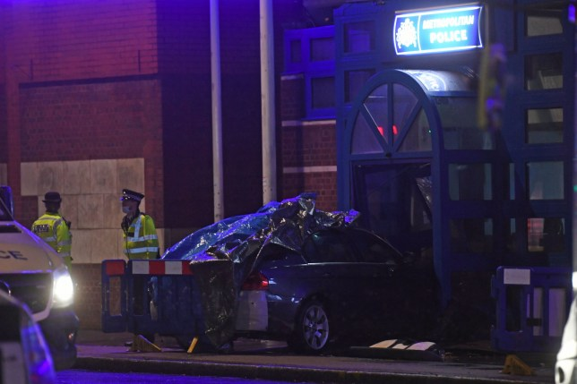 The scene at Edmonton Police Station in Enfield, north London, where a man has been arrested after a vehicle collided with the station office on Wednesday November 11, 2020.
