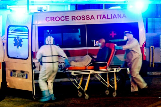 Medical staff assist people with suspected cases of COVID-19 disease, arriving at the emergency room of the Cardarelli Hospital in Naples, Italy, 13 November 2020.