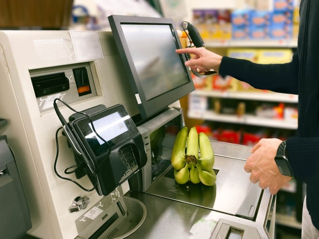 Police officer faces sack 'for sticking 7p carrot barcode on doughnuts' Close-up of unrecognizable man purchasing bananas at self-checkout kiosk in grocery store