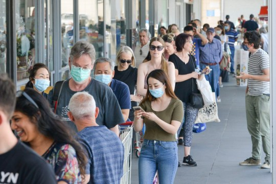 People queue at a supermarket after the South Australian state government announced a six-day lockdown because of the Covid-19 corona virus out break in Adelaide on November 18, 2020.