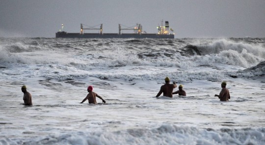 Dated: 19/11/2020 HIGH WINDS WEATHER NORTH EAST Early morning swimmers are met with large waves this morning on Tynemouth Longsands beach in North Tyneside as high winds hit the North East of England coastline today