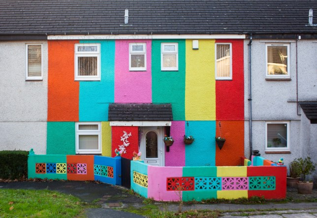 Karen Goldsmith's home in Tyndale Close in Plymouth, Devon. 19th November 2020. See SWNS story SWPLhouse; A wife was shocked when her husband painted their house all the colours of the rainbow as a 'surprise' while she was away on holiday. Karen Goldsmith, 59, lives with her husband, Mike, who has wanted to paint their house ever since a holiday to Albufeira, Portugal. He loved the colourful buildings near the water, and wanted to do the same to his house in Plymouth, Devon - but Karen wouldn't let him. They one day she went on a city break to London with her daughter - and when she returned her house was painted all the colours of the rainbow.