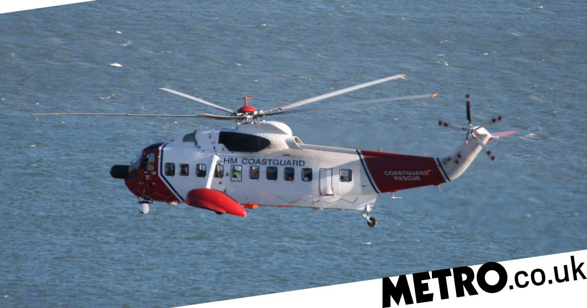 Man pulled from sea but two others still missing as fishing boat sinks