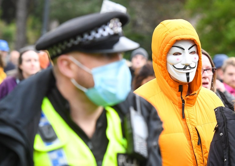 Anti-lockdown protester is seen in Guy Fawkes mask