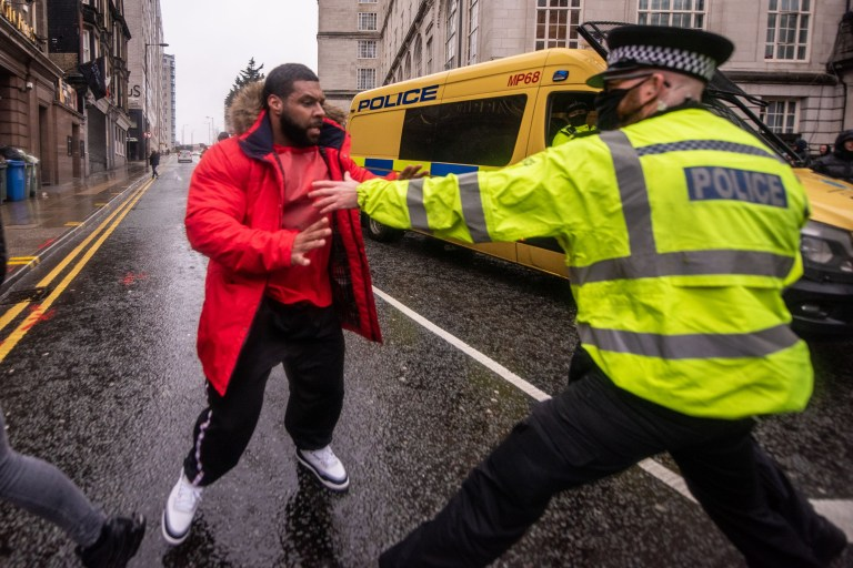 Anti-lockdown protester tries to get past police in Liverpool