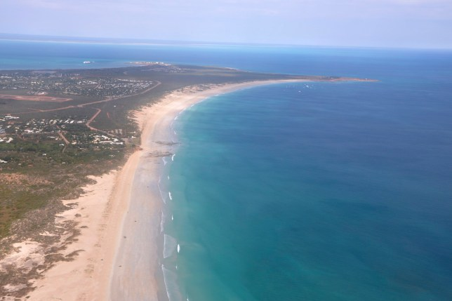 This aerial photo shows Cable Beach and the town of Broome, Western Australia, on June 24, 2014. A 55-year-old man died Sunday, Nov. 22, 2020 after being attacked by a shark off Cable Beach, a popular tourist spot on Australia???s Indian Ocean coast, the eighth fatality in the country this year. (Kim Christian/AAP Image via AP)
