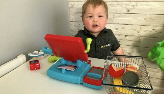 Lincoln Norris with shopkeeping toys