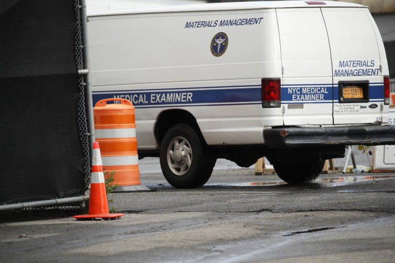 NEW YORK, NEW YORK - NOVEMBER 23: A medical examiner's van leaves a disaster morgue where refrigerated morgue trailers believed to be holding the bodies of people who died of COVID-19 are at South Brooklyn Marine Terminal on November 23, 2020 in New York City. According to recent reports, it is estimated that about 650 bodies are being stored in the trailers at a temporary emergency morgue that was set up in April until funeral homes or crematories can accept them. Many early COVID-19 victims that are being stored are from families who can???t be located or are not able to afford a burial. (Photo by Spencer Platt/Getty Images)