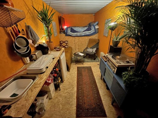 Inside Jay Adler's home, inside a shipping container