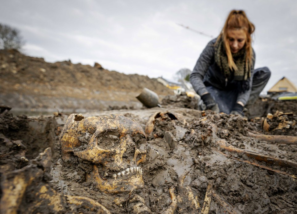Archaeologists at work at a mass grave on the city moat in Vianen, the Netherlands (Credits: EPA)