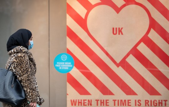 A woman walks past a sign in a shop window in Leicester, which has endured 150 days of extra lockdown, during the final week of a four week national lockdown to curb the spread of coronavirus. PA Photo. Picture date: Friday November 27, 2020. The Government has published its list outlining which parts of England will be in which tier when the national lockdown ends on December 2, with swathes of the North East and North West in Tier 3, but London will be in Tier 2. See PA story HEALTH Coronavirus. Photo credit should read: Joe Giddens/PA Wire