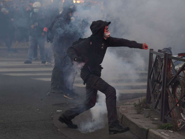 Demonstrators clashes with French riot police during a protest against the 'global security' draft law