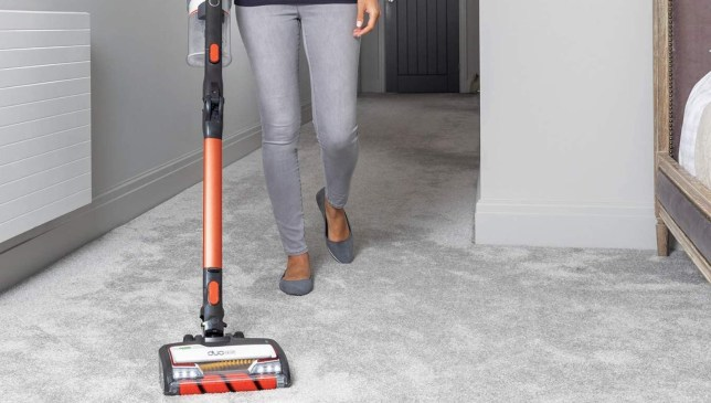 Woman using a Shark vaccum cleaner