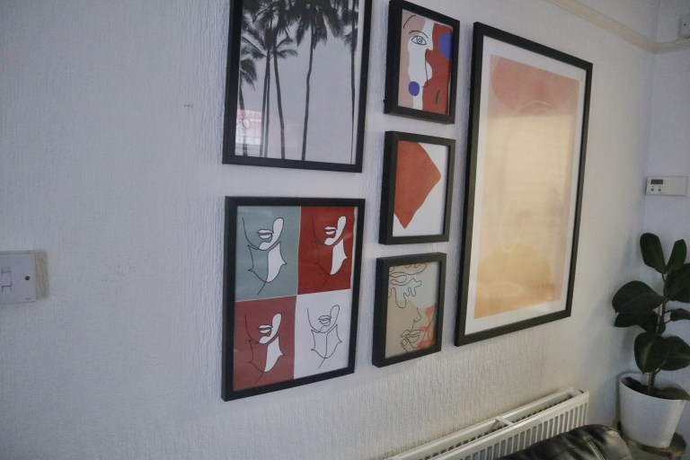 paintings and prints on the walls of beverley's one-bedroom flat