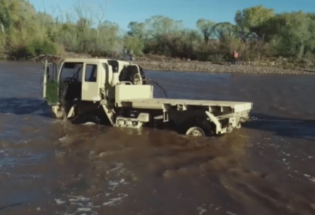 Rawlings family truck being pulled from flood waters