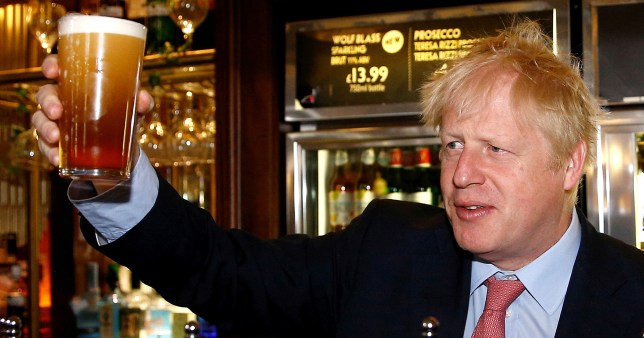 Boris Johnson with a pint in his hand